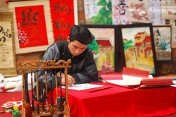 Calligraphy art on Hanoi street - Essential Vietnam tour