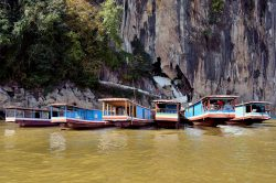 Slow Boats at Pak Ou Caves in Luang Prabang - Laos family adventure with Hanoi Voyages
