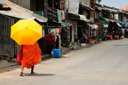 Phnom Penh monks with a yellow umbrella