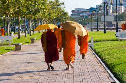 Cambodian monks walking on the streets of Phnom Penh - Highlights of Cambodia