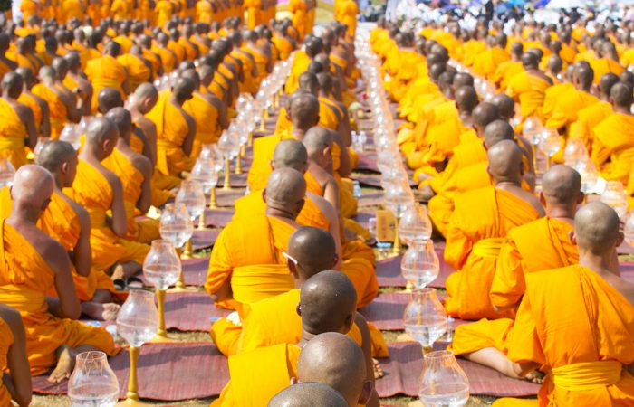 buddist monks praying : highlights of Thailand tour