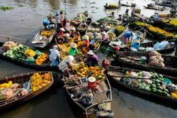 floating market in mekong delta - essential tour in vietnam