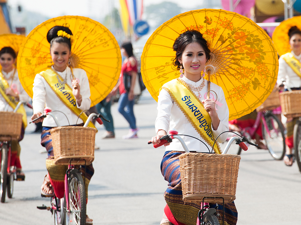 Colorfuly dressed Thai women in traditional dresses