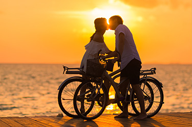 Tailor-made holidays couple kissing sunset