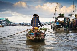 Floating market in the Mekong Delta - Essential Vietnam tour