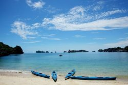 Swimming and kayaking at Van Boi Beach - Vietnam Nature Tour with Hanoi Voyages