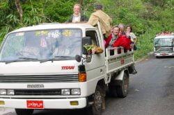 Hop on a open-top local truck in Kin Pun - Myanmar tour of splendours
