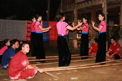 White Thai girls dancing in Mai Chau - Vietnam Nature tour with Hanoi Voyages