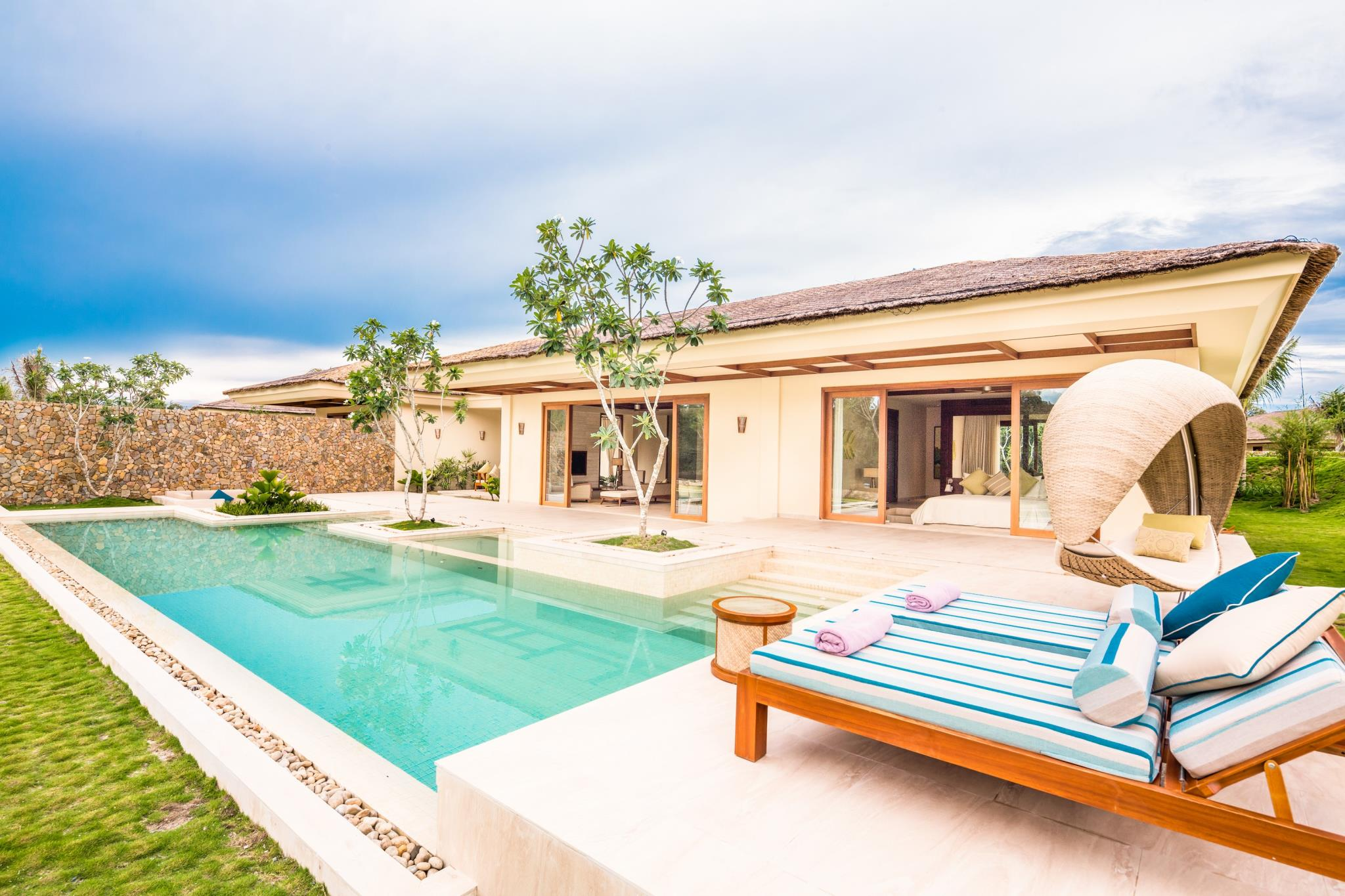 Fusion Resort Phu Quoc Villa loungers and pool