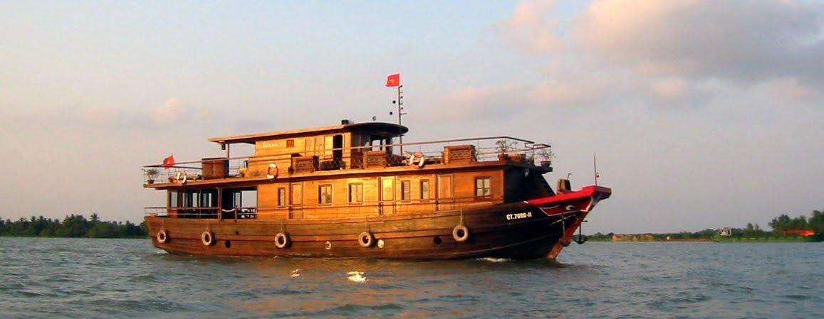 bassac river cruise boat at sunset