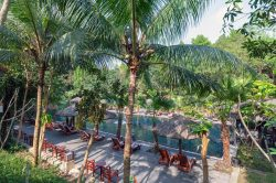 pilgrimage village resort and its swimming pool and sun lounger area