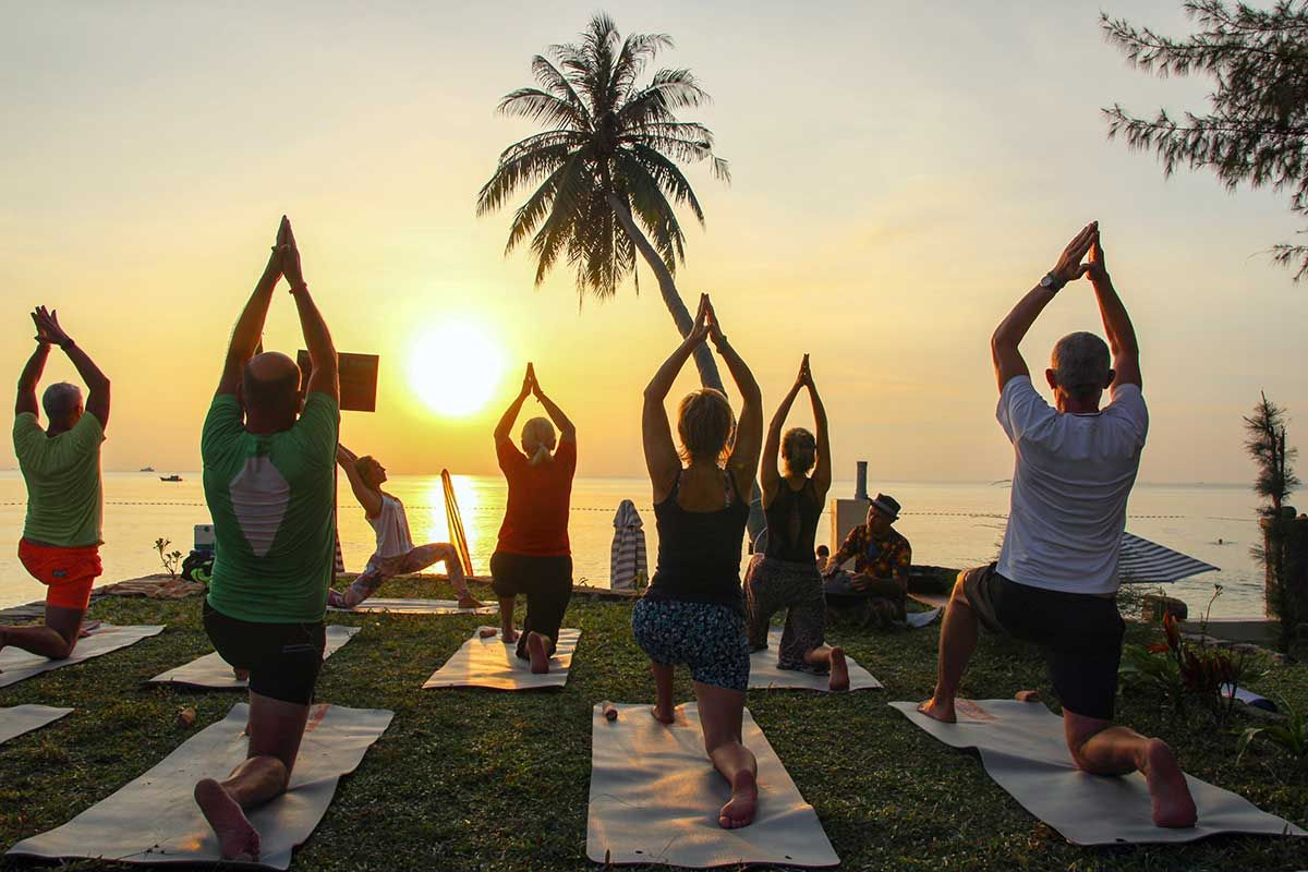 People practicing yoga at Phu Quoc Cassia Cottage Resort