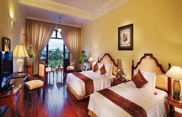 Beds in Colonial Deluxe Room, Saigon Morin
